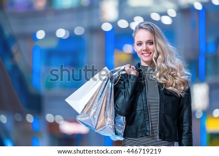 Young woman with bags - stock photo