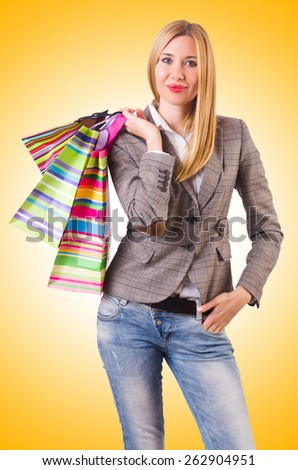 Young woman with bags after shopping - stock photo