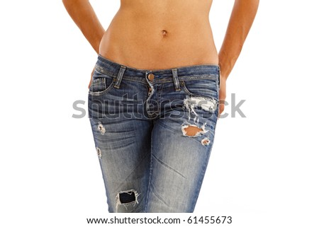 Young woman with bare top wearing worn jeans