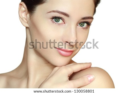 Young woman with beautiful clean face isolated on white background looking calm - stock photo