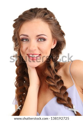 Young woman with beautiful hairstyle, isolated on white - stock photo
