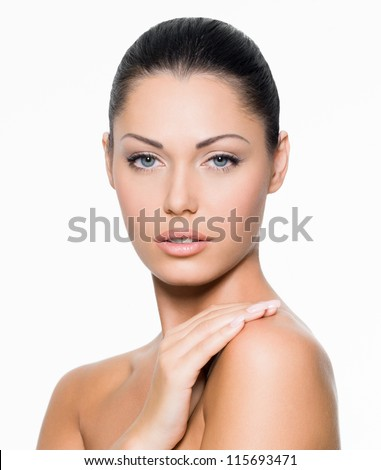 Young woman with beautiful healthy face - isolated on white - stock photo
