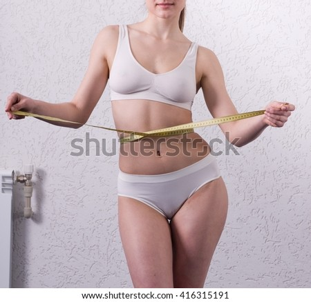 Young woman with beautiful sporty body  - stock photo