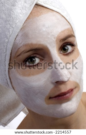 young woman with beauty mask on white