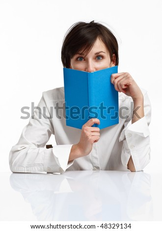young woman with big blue eyes holding a book, looking to the viewer on white background - stock photo
