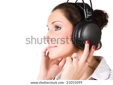 Young woman with big headphones. Isolated on white.