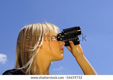 young woman with binoculars - stock photo