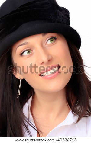 Young woman with black hat and black hair