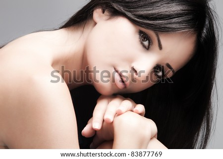 young woman with black long straight hair, beauty portrait - stock photo