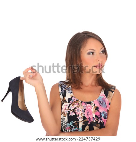Young woman with black shoe, studio isolated on white - stock photo
