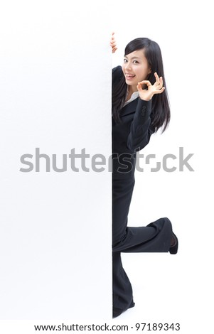 young woman with blank billboard showing OK, isolated on white background