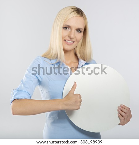 young woman with blank circle board and showing thumb up sign
