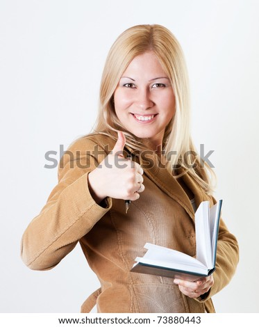 Young woman with blond hair and her thumb up