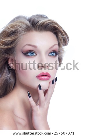 Young woman with blowing hair, high end beauty cosmetics, isolated on white - stock photo