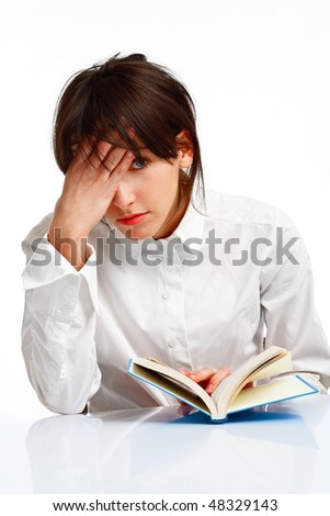 young woman with blue eyes reading a book, tired and giving up, on white background - stock photo