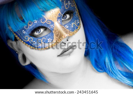 Young woman with blue hair, wearing a mask,  - stock photo