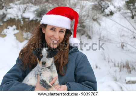 Young Woman with Blue Heeler Puppy at Christmas time. - stock photo