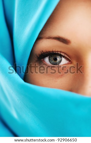 Young woman with blue scarf - stock photo