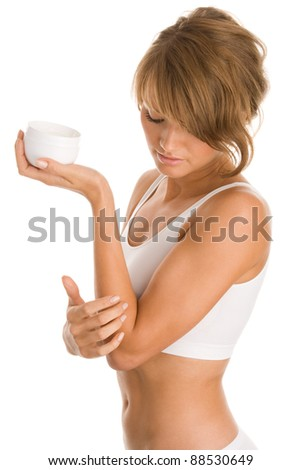 Young woman with body lotion