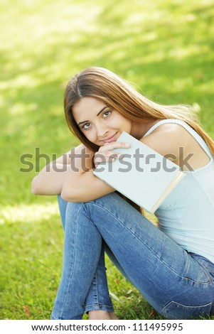 Young woman with book, copy space