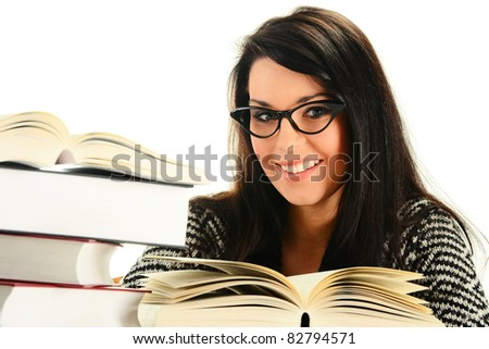 Young woman with books isolated on white. Female student learning - stock photo
