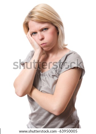 young woman with bored expression isolated on white - stock photo