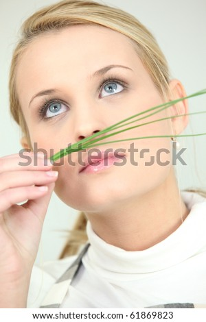 Young woman with branch chives