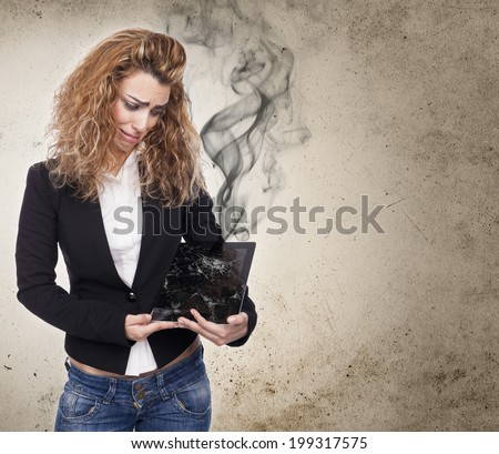 young woman with broken tablet