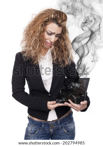 young woman with broken tablet - stock photo