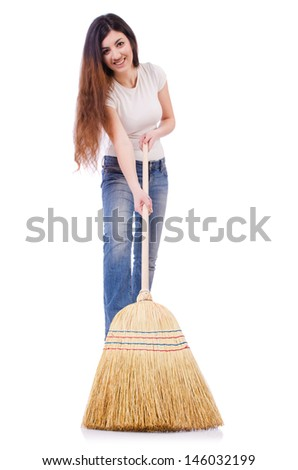 Young woman with broom isolated on white - stock photo