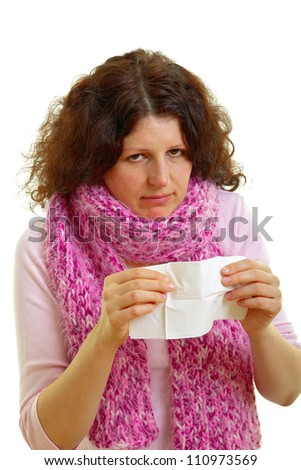 Young woman with brown hair blows his nose, isolated on white background, studio shot. - stock photo