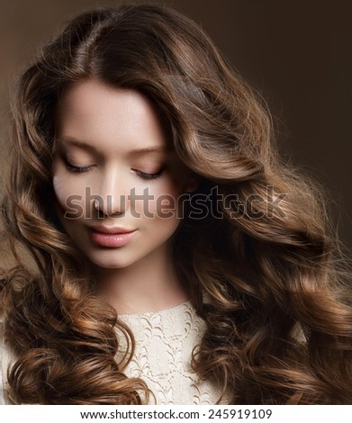 Young Woman with Brown Hair in Reverie - stock photo