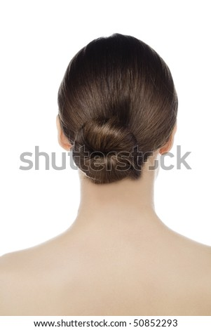 young woman with bun in hair - stock photo