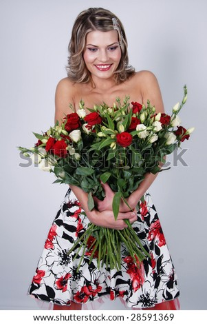 Young woman with bunch of flowers - stock photo
