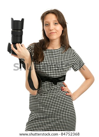 young woman with camera - stock photo