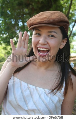 Young woman with cap shouting out loud - stock photo