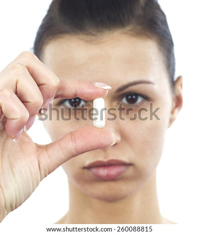 Young woman with capsule - stock photo