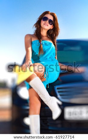 Young woman with car. Selective focus effect. - stock photo