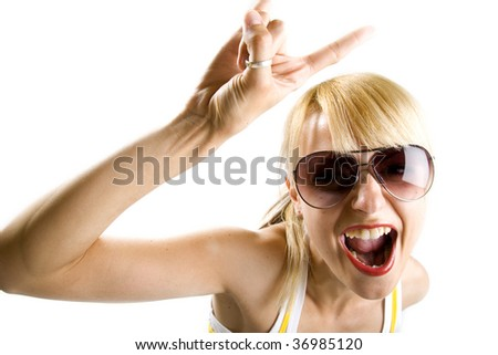 Young woman with characteristic heavy metal hand gesture