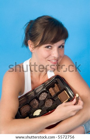 young woman with chocolate and candies - stock photo