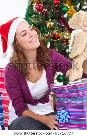 young woman with christmas gift - stock photo