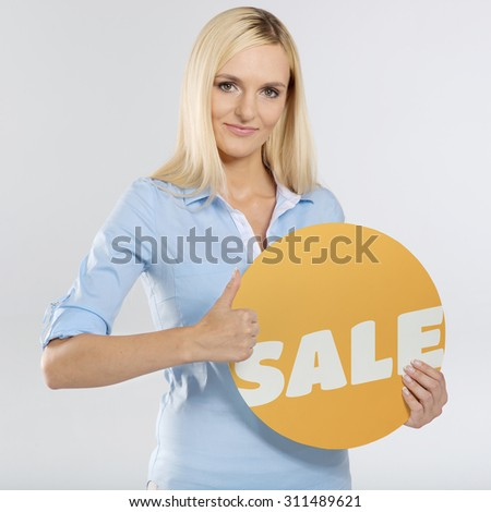 young woman with circle board and showing thumb up sign - stock photo