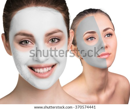 Young woman with clay face mask - stock photo