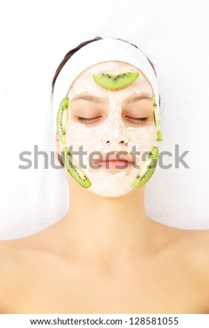 Young woman with clay facial mask