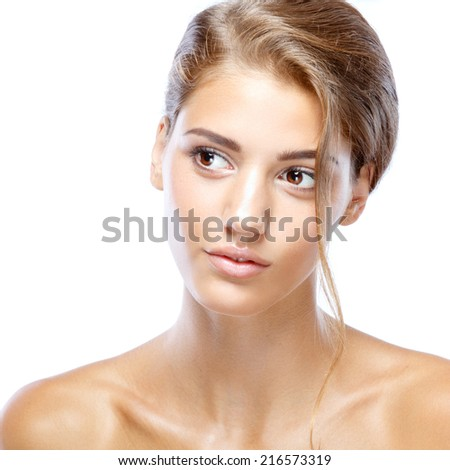 Young woman with clear face natural make up her hair up on a white isolated background - stock photo