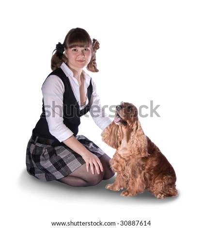 young woman with cocker spaniel over white