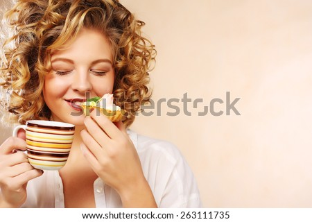 young woman with coffee and cookies. - stock photo