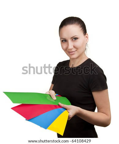 Young woman with color paper in hands