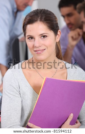 Young woman with colored A4 paper - stock photo