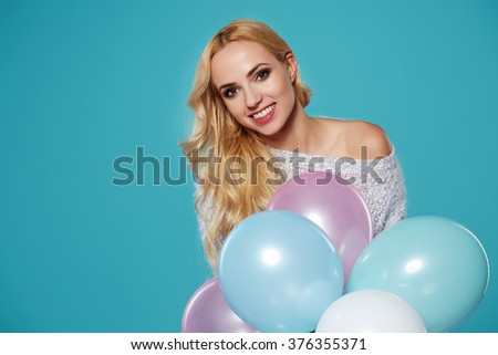 Young  woman with colored balloons - stock photo